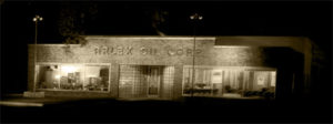 old arlex oil corporation building with lights on