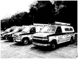 black and white photo of arlex oil vans lined up
